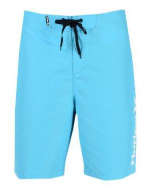 Пляжные брюки и шорты HURLEY. Цвет: лазурный