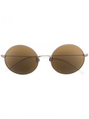 Солнцезащитные очки в круглой оправе Ann Demeulemeester. Цвет: металлический