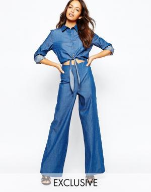 Never Fully Dressed Джинсовый комбинезон с завязкой на топе. Цвет: джинсовая ткань цвет