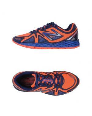 Низкие кеды и кроссовки NEW BALANCE. Цвет: оранжевый