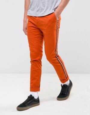 ASOS Оранжевые зауженные чиносы с контрастными полосками по бокам. Цвет: оранжевый