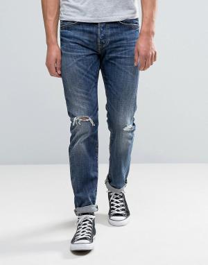 Edwin Темные суженные книзу джинсы с прорехами ED-80. Цвет: синий