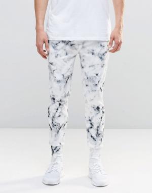 N1SQ Джоггеры с мраморным принтом. Цвет: белый