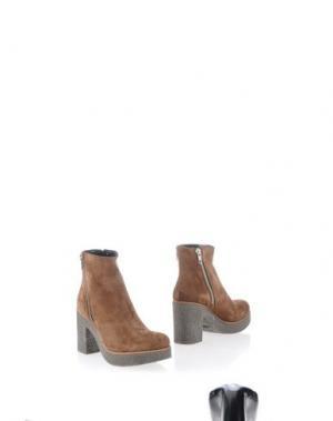 Полусапоги и высокие ботинки STELE. Цвет: светло-коричневый