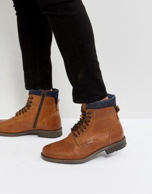 Levis Коричневые кожаные ботинки с джинсовой отделкой Emmerson. Цвет: коричневый
