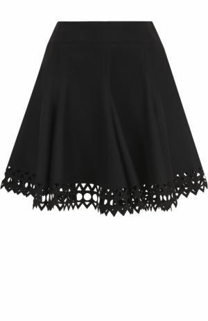 Шерстяная мини-юбка с перфорацией Alaia. Цвет: черный