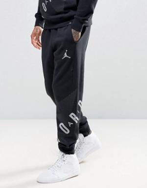 Jordan Джоггеры с большим логотипом Nike 833920-010. Цвет: черный