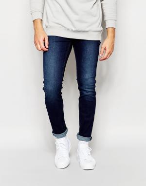 Cheap Monday Темные зауженные эластичные джинсы. Цвет: синий