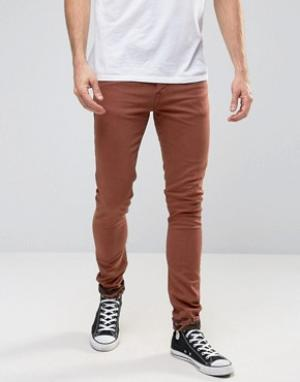 ASOS Ржавые супероблегающие джинсы с камуфляжными отворотами. Цвет: коричневый