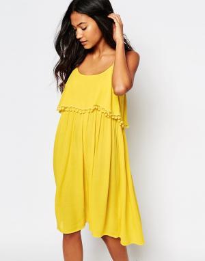 Akasa Пляжное платье с помпонами сзади. Цвет: желтый