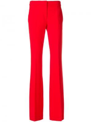 Расклешенные брюки Moschino. Цвет: красный
