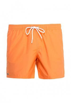 Шорты для плавания Lacoste. Цвет: оранжевый