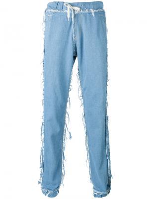 Свободные джинсы с необработанными краями Andrea Crews. Цвет: синий