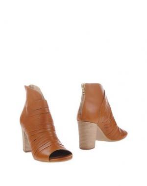 Полусапоги и высокие ботинки MANAS. Цвет: желто-коричневый