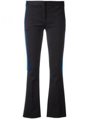 Расклешенные брюки с лампасами Versace. Цвет: чёрный