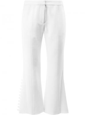 Укороченные расклешенные брюки Alexis. Цвет: белый