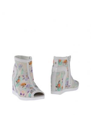 Полусапоги и высокие ботинки RUCO LINE. Цвет: светло-зеленый