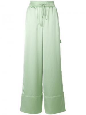 Атласные широкие брюки Off-White. Цвет: зелёный
