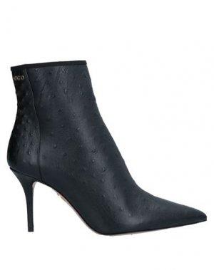 Полусапоги и высокие ботинки CHARLOTTE OLYMPIA. Цвет: черный