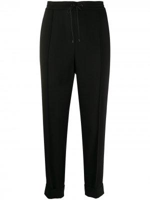 Зауженные брюки со складками Kenzo. Цвет: черный