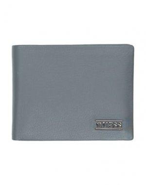 Бумажник GUESS. Цвет: свинцово-серый