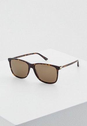Очки солнцезащитные Gucci GG0017S002. Цвет: коричневый