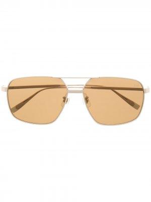 Солнцезащитные очки-авиаторы Dunhill. Цвет: золотистый