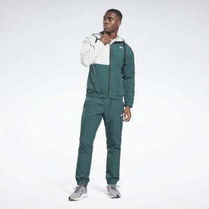 Спортивный костюм Woven Reebok. Цвет: forest green