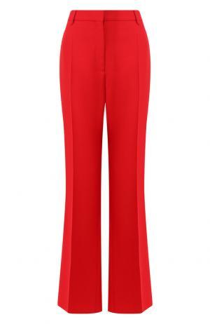 Расклешенные брюки из смеси шерсти и шелка Valentino. Цвет: красный