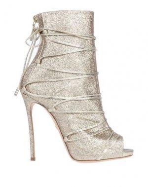 Полусапоги и высокие ботинки DSQUARED2. Цвет: золотистый