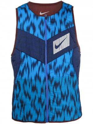 Двусторонний жилет Nike. Цвет: синий
