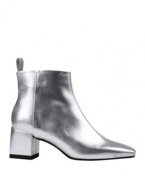 Полусапоги и высокие ботинки CALVIN KLEIN. Цвет: серебристый