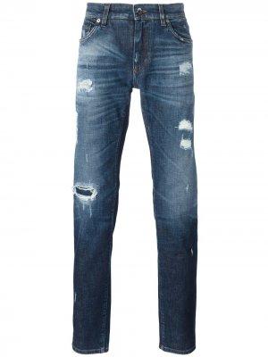 Джинсы с рваными деталями Dolce & Gabbana. Цвет: синий
