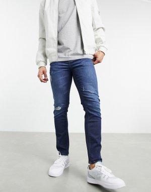 Темно-синие зауженные джинсы до щиколотки с эффектом потертости и рваной отделкой, изготовленные уменьшенным расходом воды, -Голубой ASOS DESIGN