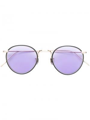 Солнцезащитные очки в круглой оправе Eyevan7285. Цвет: золотистый