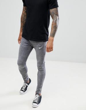 Серые джинсы супероблегающего кроя Bershka. Цвет: серый