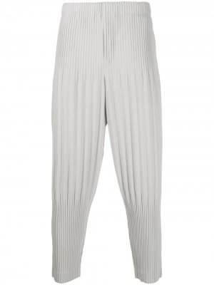 Плиссированные зауженные брюки Homme Plissé Issey Miyake. Цвет: серый