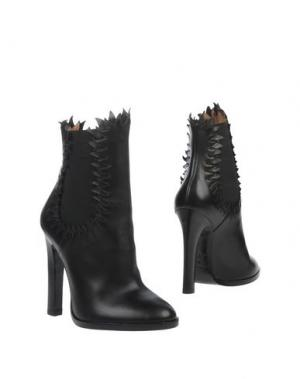 Полусапоги и высокие ботинки ALAÏA. Цвет: черный