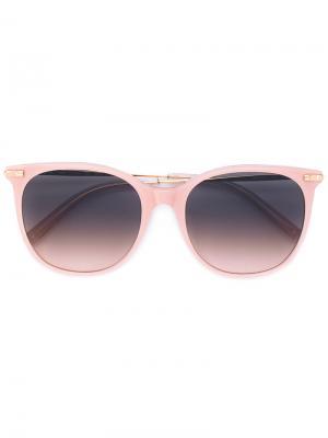 Солнцезащитные очки в круглой оправе Boucheron. Цвет: телесный