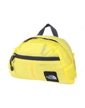 Рюкзаки и сумки на пояс THE NORTH FACE. Цвет: желтый