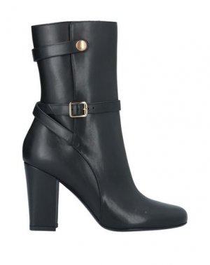 Полусапоги и высокие ботинки THEORY. Цвет: черный