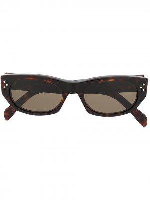 Солнцезащитные очки в круглой оправе черепаховой расцветки Celine Eyewear. Цвет: коричневый