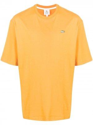 Футболка с круглым вырезом и нашивкой-логотипом Lacoste. Цвет: оранжевый
