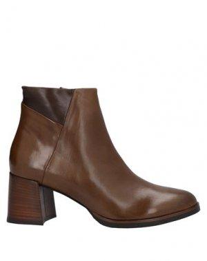 Полусапоги и высокие ботинки CALPIERRE. Цвет: верблюжий