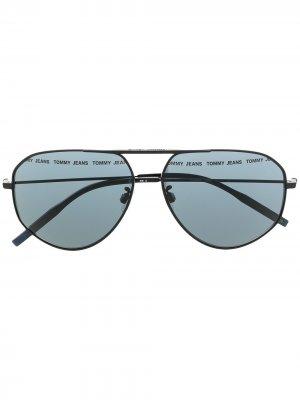 Солнцезащитные очки-авиаторы Tommy Jeans. Цвет: черный