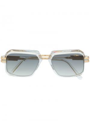 Солнцезащитные очки в массивной оправе Cazal. Цвет: золотистый