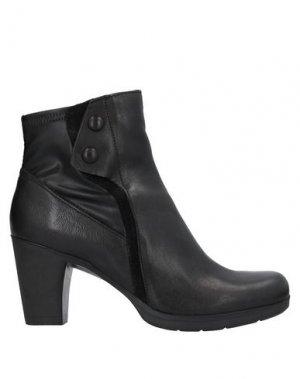 Полусапоги и высокие ботинки KHRIO'. Цвет: черный