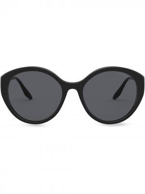 Солнцезащитные очки в круглой оправе Prada Eyewear. Цвет: черный