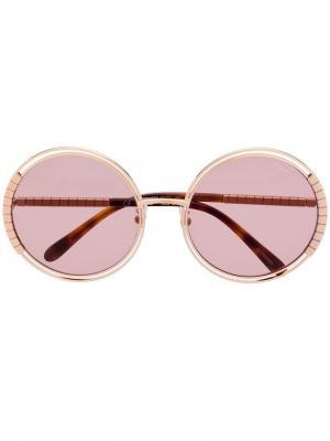 Солнцезащитные очки в круглой оправе Chopard Eyewear. Цвет: золотистый