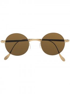 Солнцезащитные очки в круглой оправе Haffmans & Neumeister. Цвет: золотистый